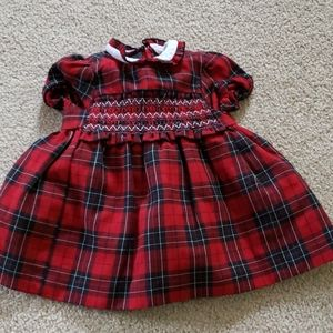 Red and black plaid dress with smocking detail
